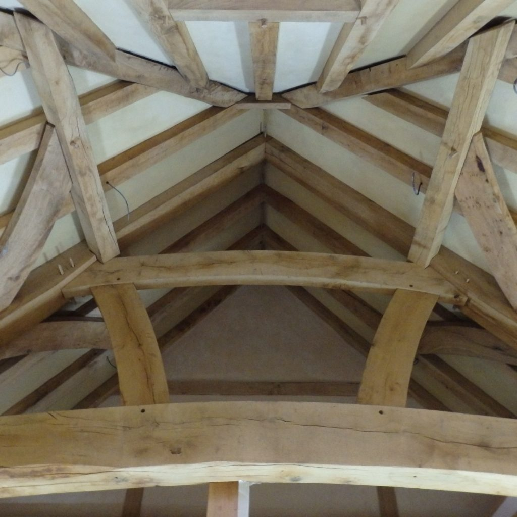 Lime plastered panels between oak beams