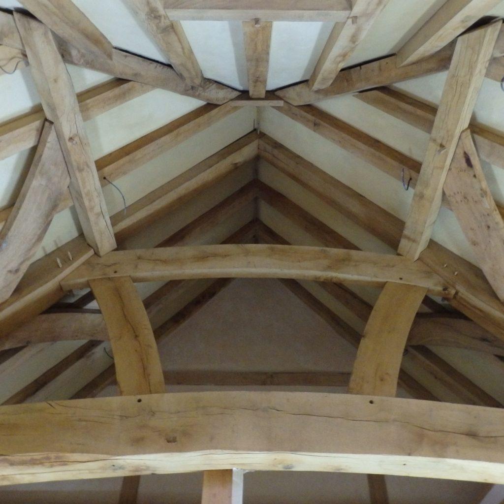 Lime plastered panels between oak beams
