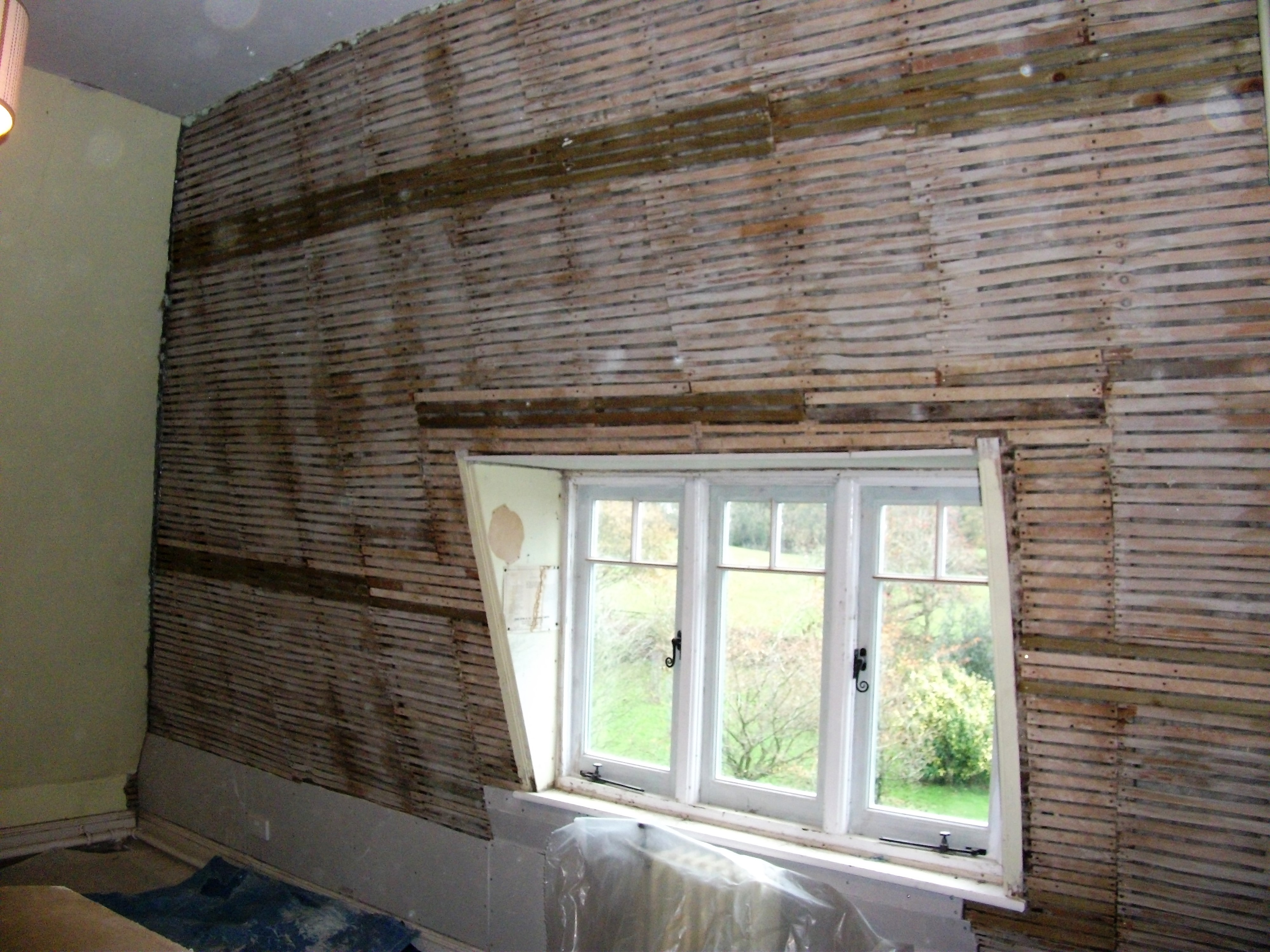 Existing laths ready for the first coat of Hemp lime plaster
