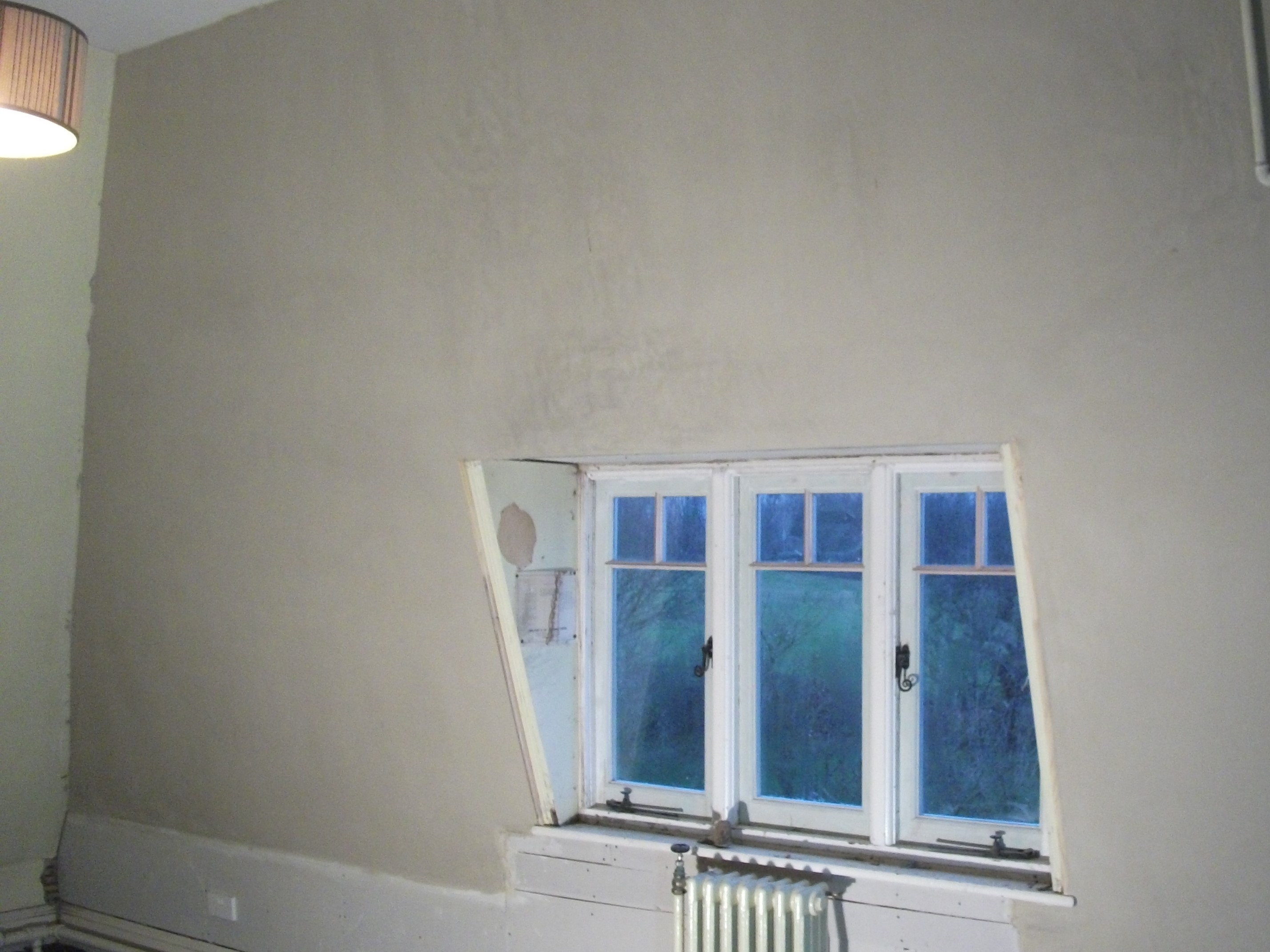 Hemp lime plastering, The lath and hemp plastered wall has been top coated with lime