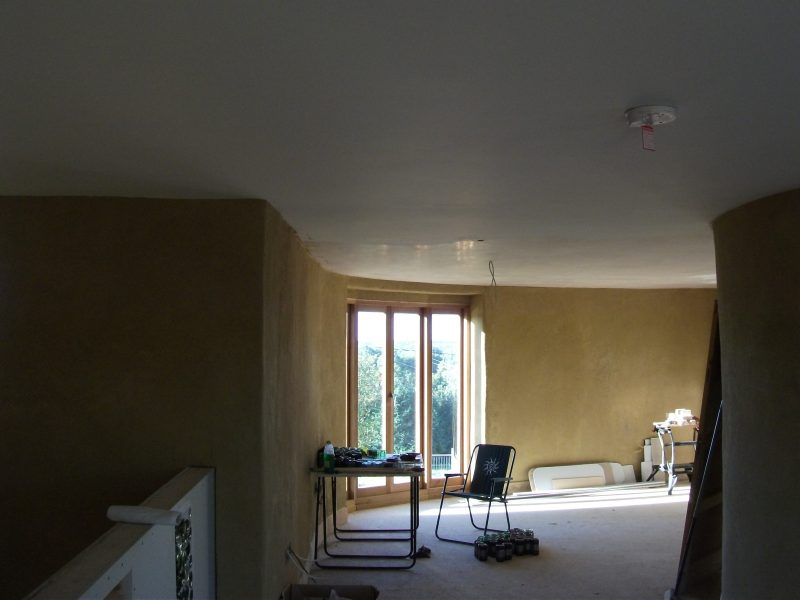 The plasterboard ceiling has been skimmed with plaster in this straw bale house, which was featured on the Channel 4 series, Building the Dream.