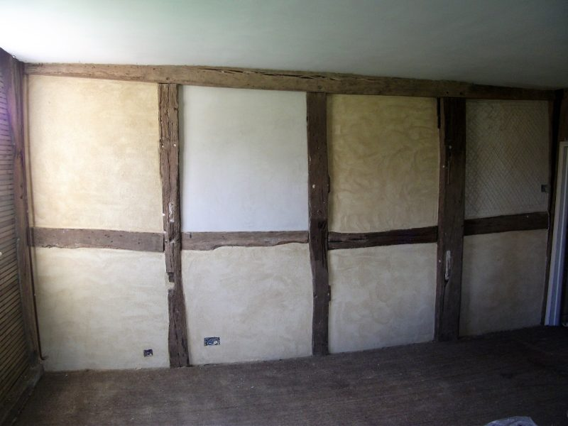 Lime plaster repairs to a timber framed wall. After. 2013